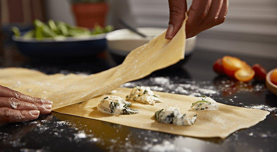 Making homemade ravioli pasta with cheese filling