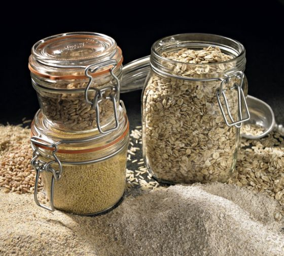 Three jars filled with grains and different spices