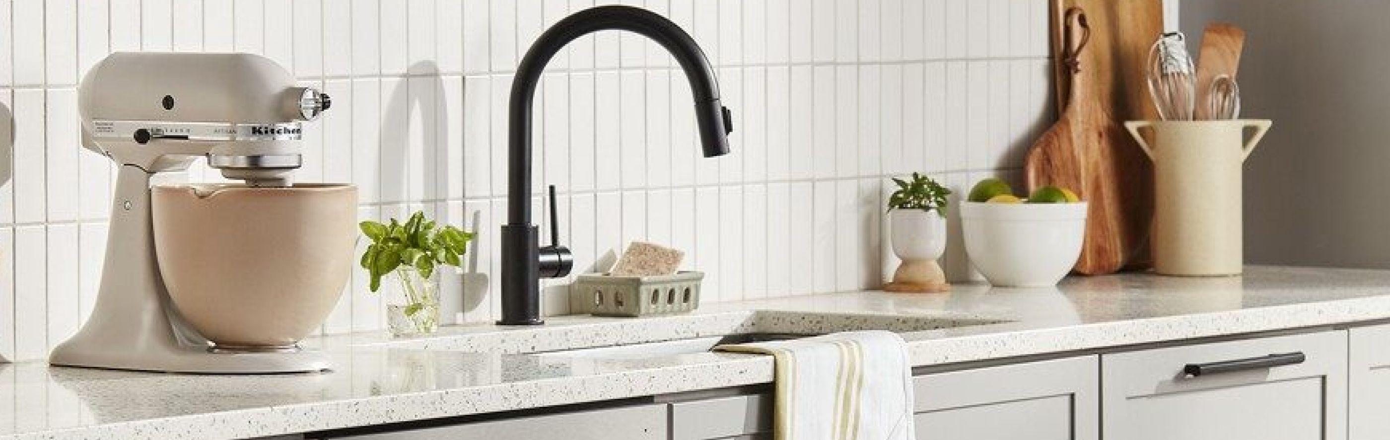KitchenAid® stand mixer on a countertop next to a kitchen sink