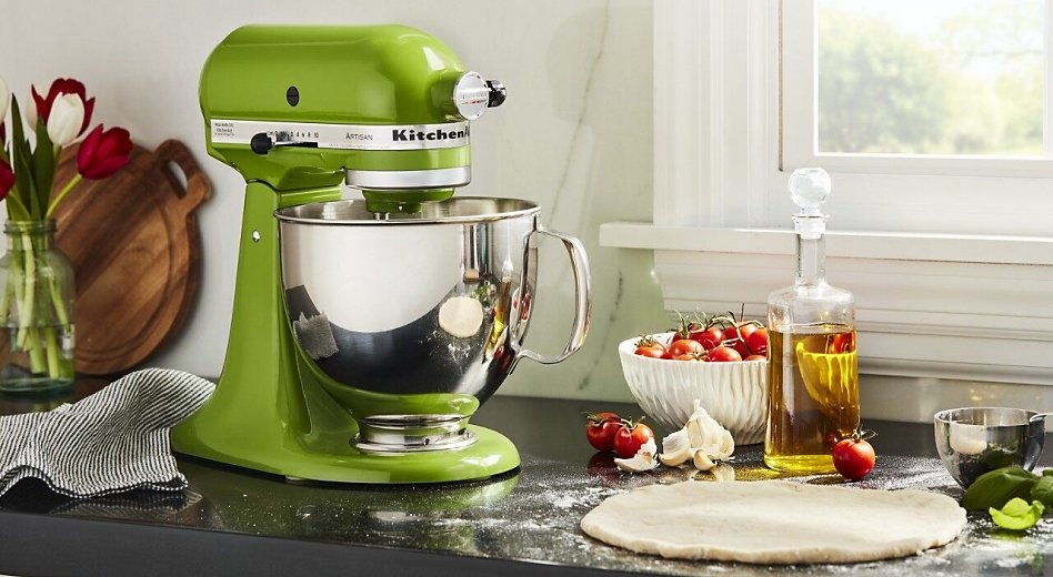 Green stand mixer on counter with rolled out dough