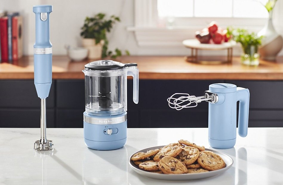 Blue KitchenAid® cordless collection appliances on counter with cookies