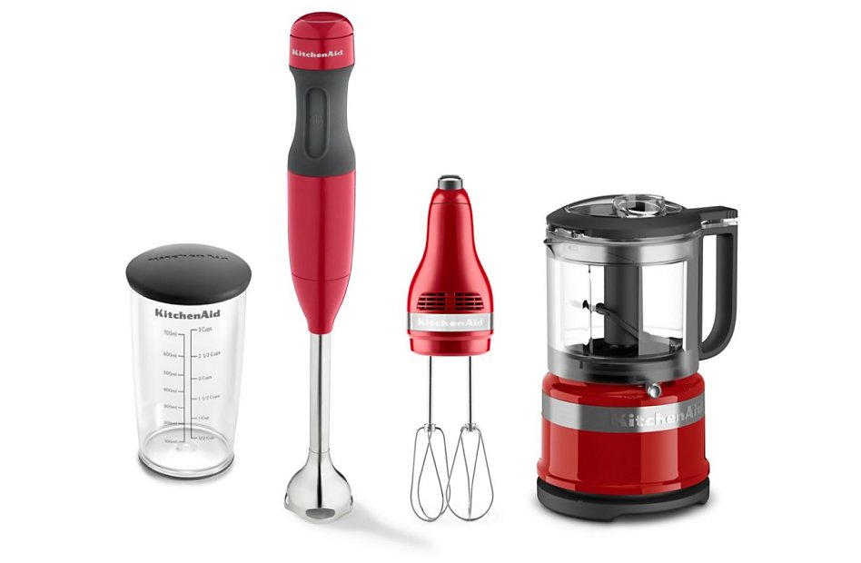 Various red KitchenAid® countertop appliances in a row