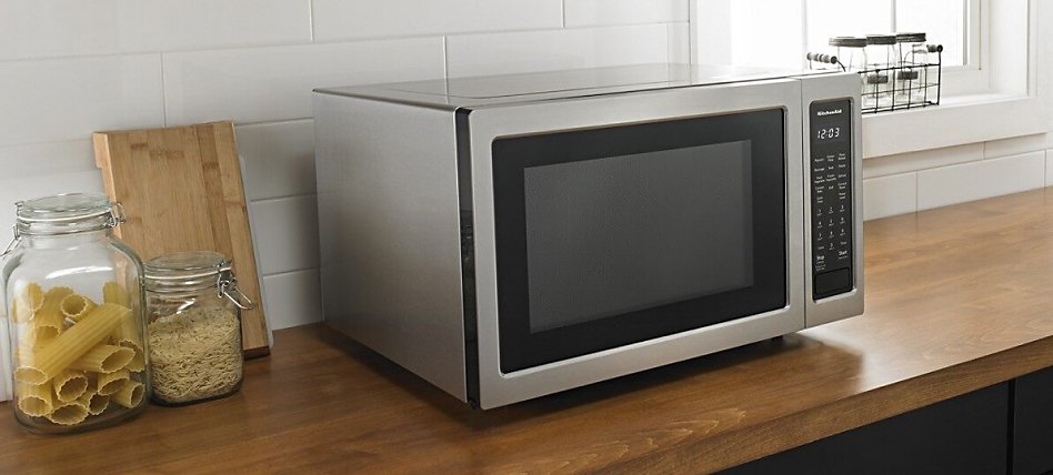 Microwave on a wood countertop