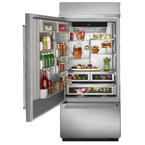 Open stainless steel bottom freezer type of fridge with food inside