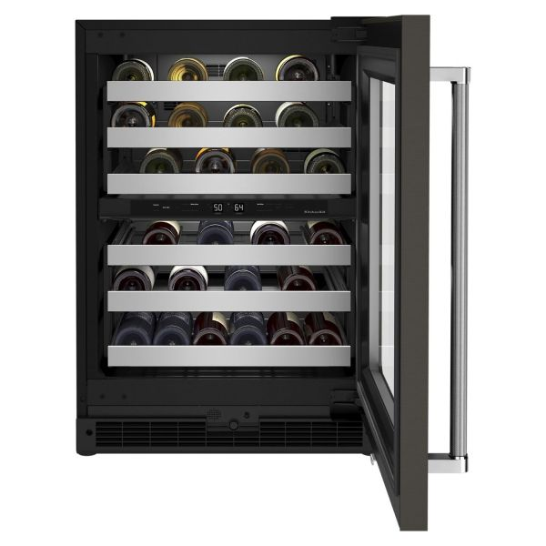 Open wine cellar style of refrigerator full of red and white wine