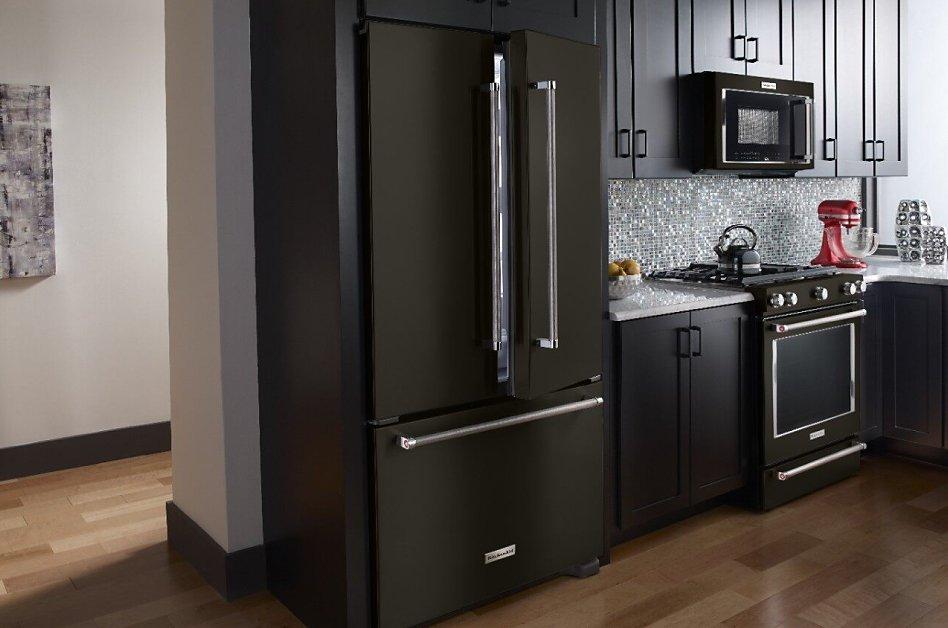 Black stainless steel refrigerator style in dark, modern kitchen