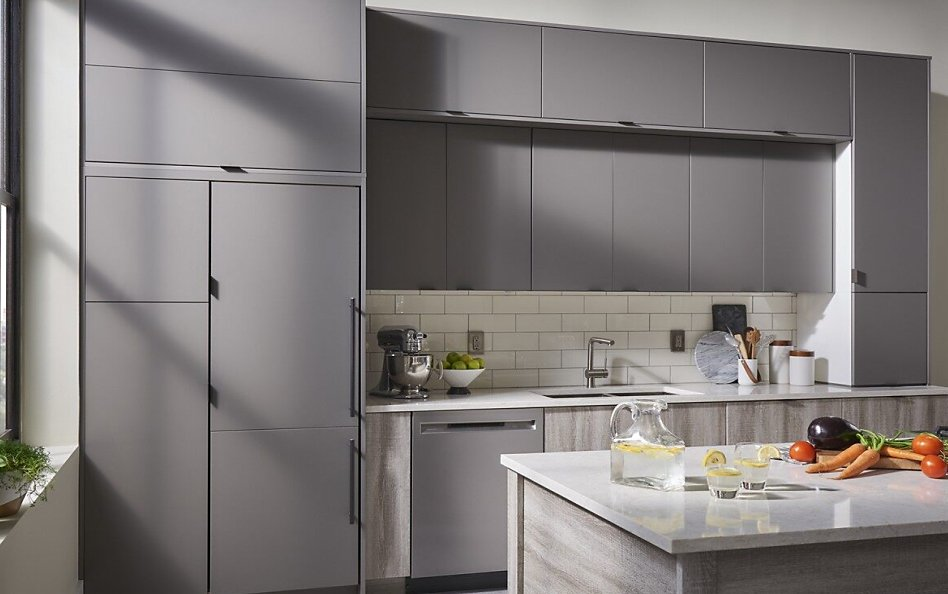 Minimal kitchen with gray cabinets and panel-ready refrigerator