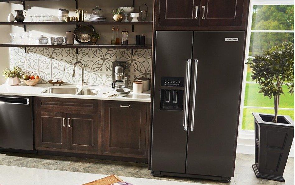 Black stainless steel full-depth refrigerator style in kitchen