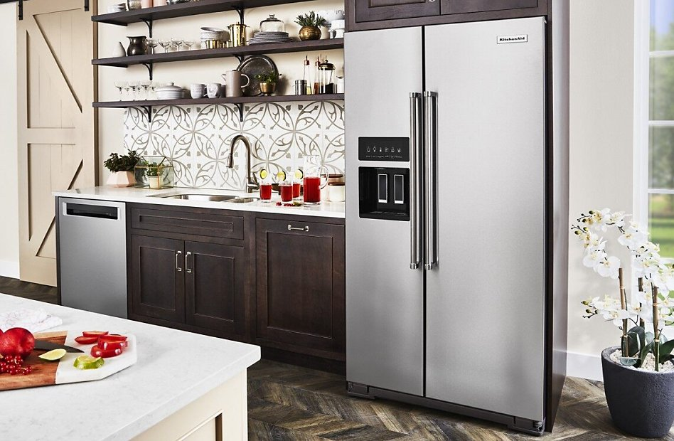 Stainless steel counter-depth refrigerator style in kitchen