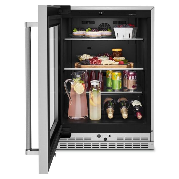 Open undercounter refrigerator with appetizers and drinks inside