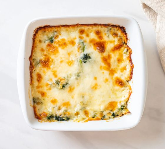 A cheesy-looking dip in a white dish