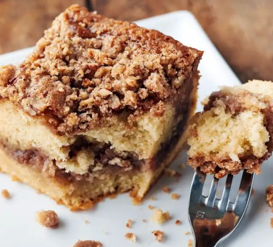 A slice of cake with crumb topping