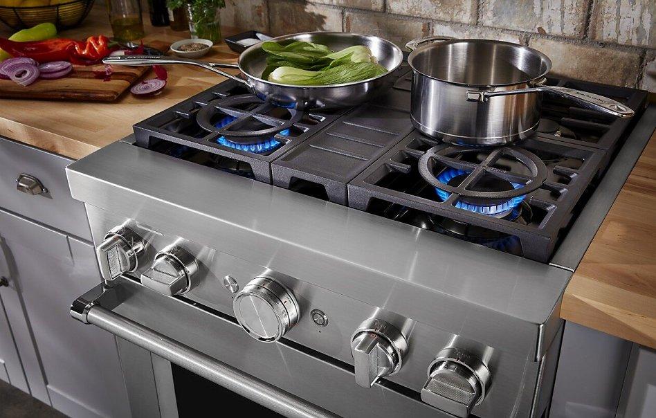 Pot and pan on gas range stovetop
