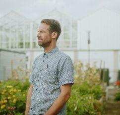 Michael M. More admiring his garden.