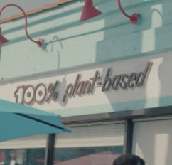 A sign that says 100% plant-based.