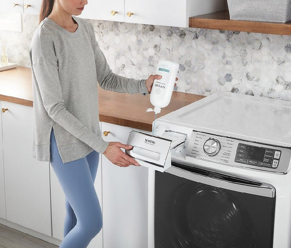 Woman using Swash detergent with washing machine