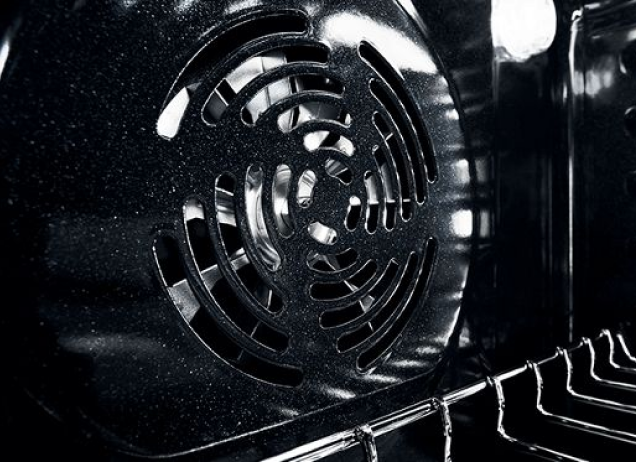 Internal view of a Maytag oven convection fan.
