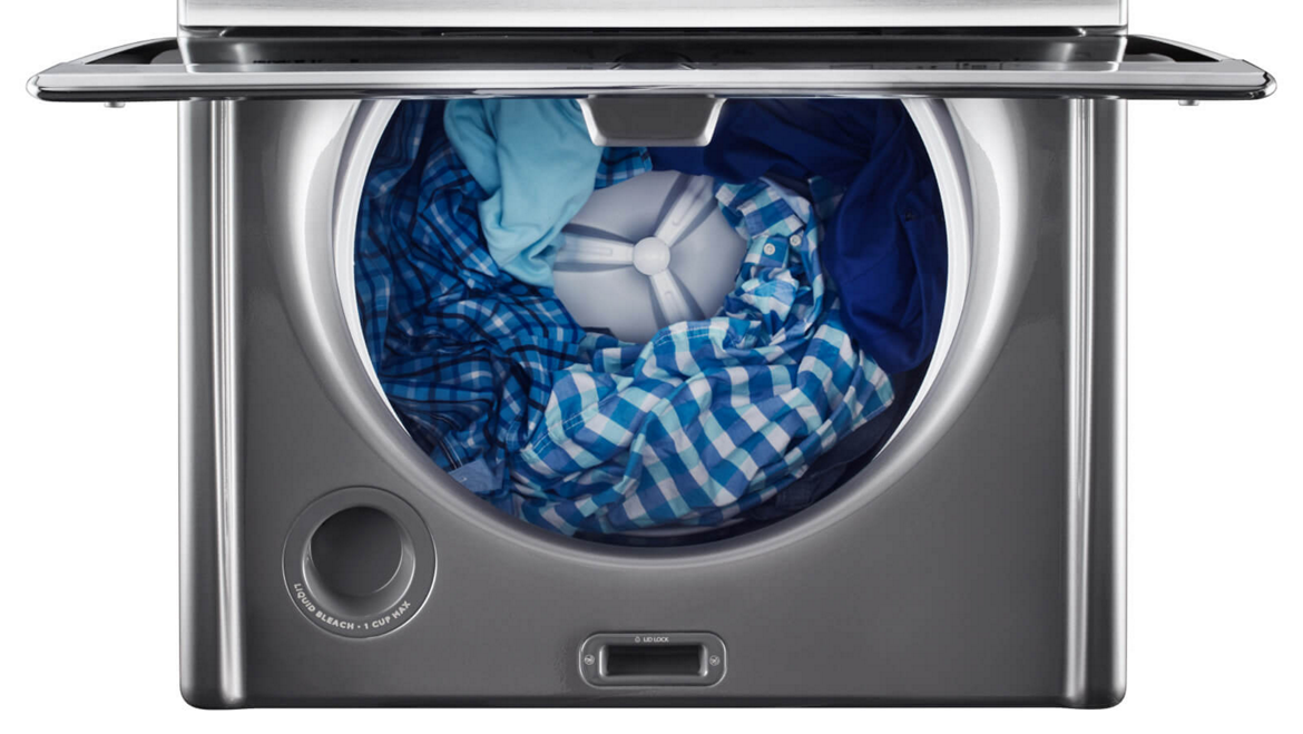 Maytag® top-load washer properly loaded with clothes.