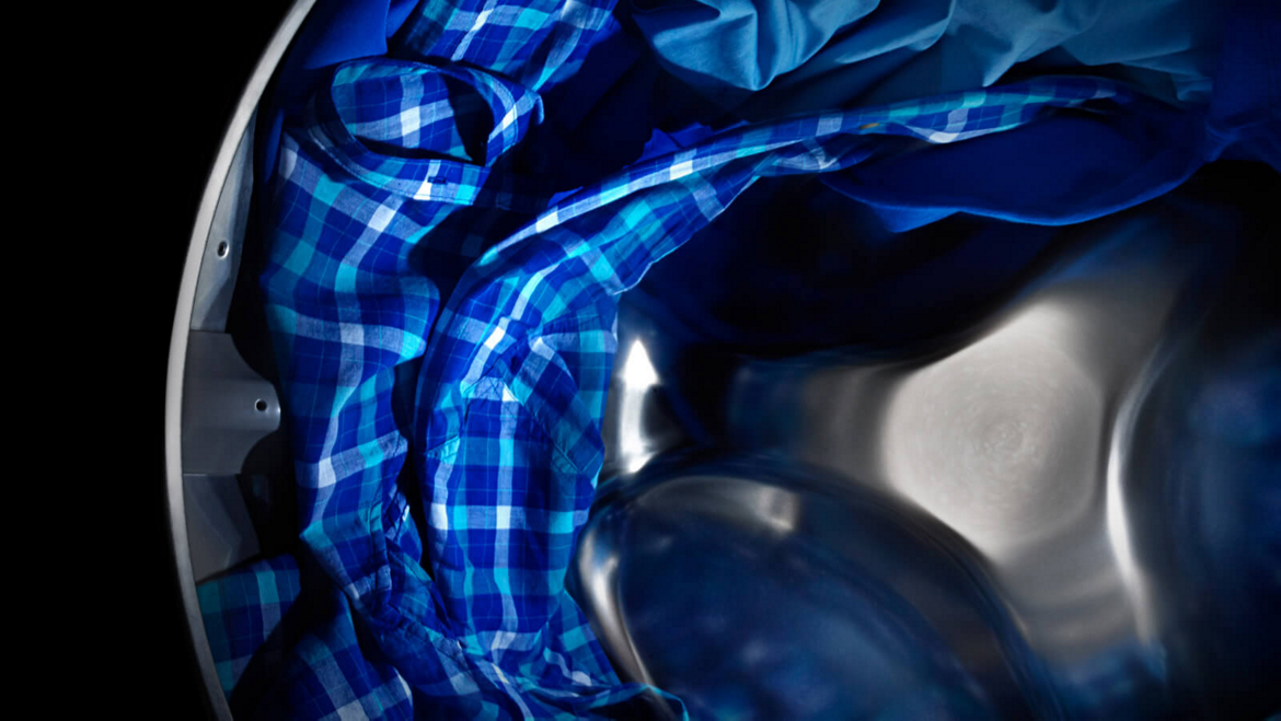 Maytag® dryer tumbling blue clothes.