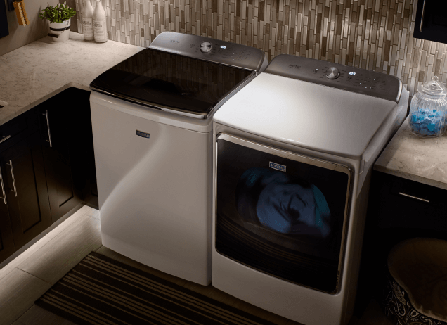 Maytag® washer and dryer pair installed in a laundry room.