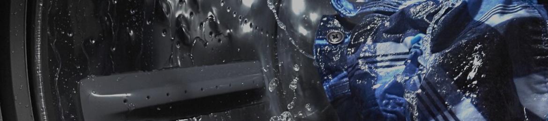 Internal view of a Maytag® washing machine washing clothes.
