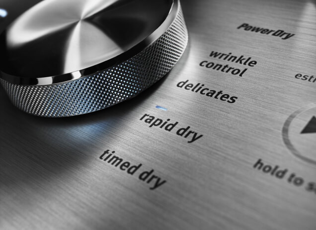 Close-up of Maytag® washing machine controls in stainless steel.