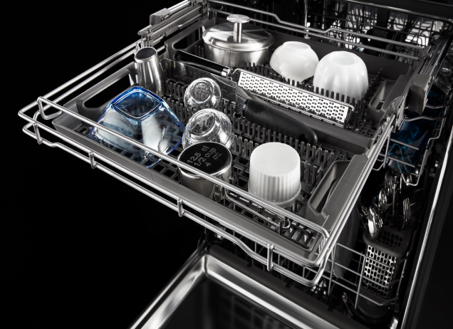 The top rack of a Maytag dishwasher filled with cups and bowls.