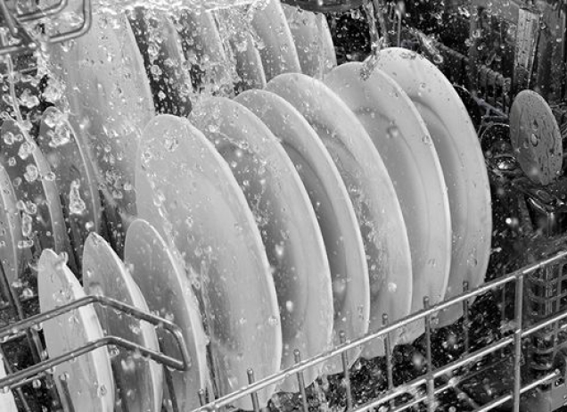 Water splashing on the dishes inside a dishwasher