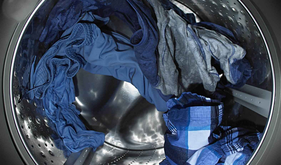 Wet clothes tumbling in washer