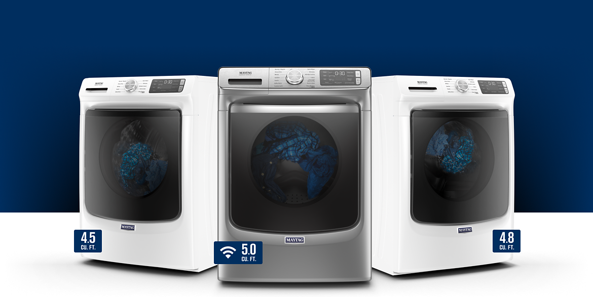 View of three heavy duty Maytag washers in stainless steel