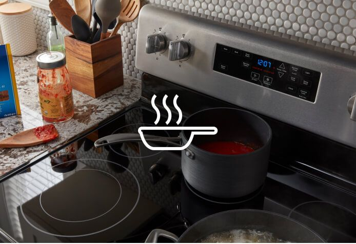 Sauce warming on the warming center of a Maytag® range.
