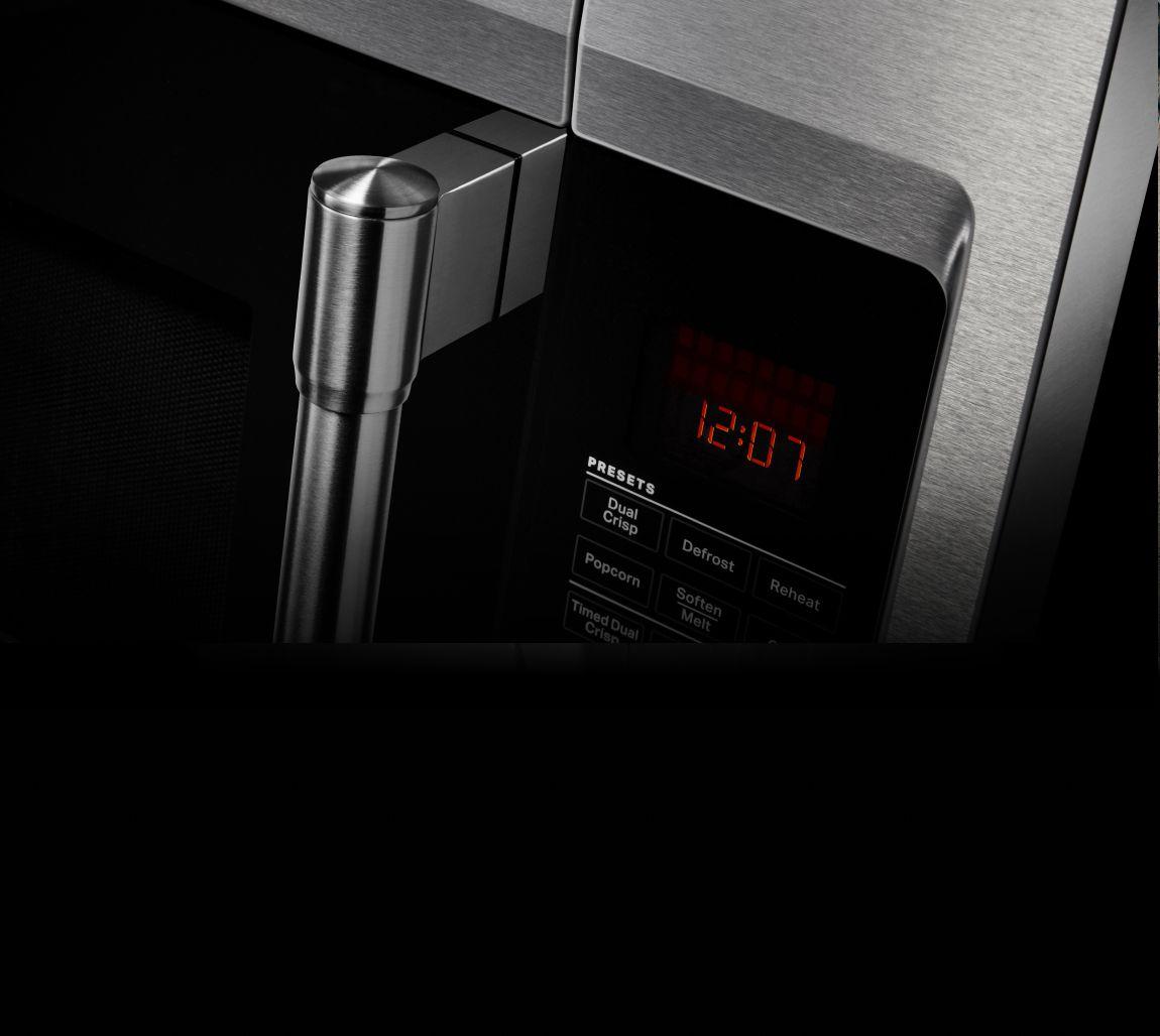 Closeup of a Maytag® microwave door handle.