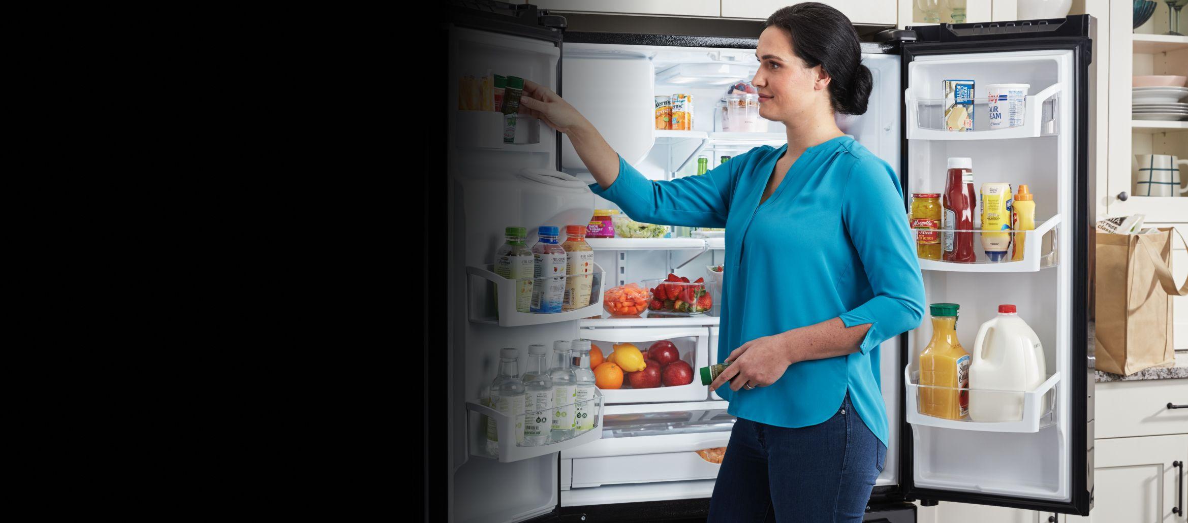 An open Maytag® refrigerator.