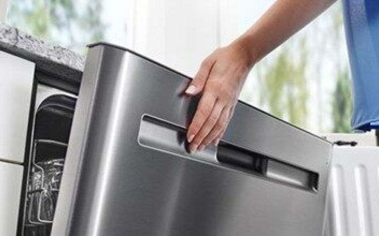 Hand closing stainless steel dishwasher.