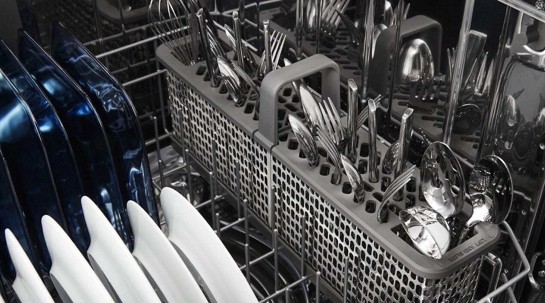 View of dishwasher bottom rack and silverware basket