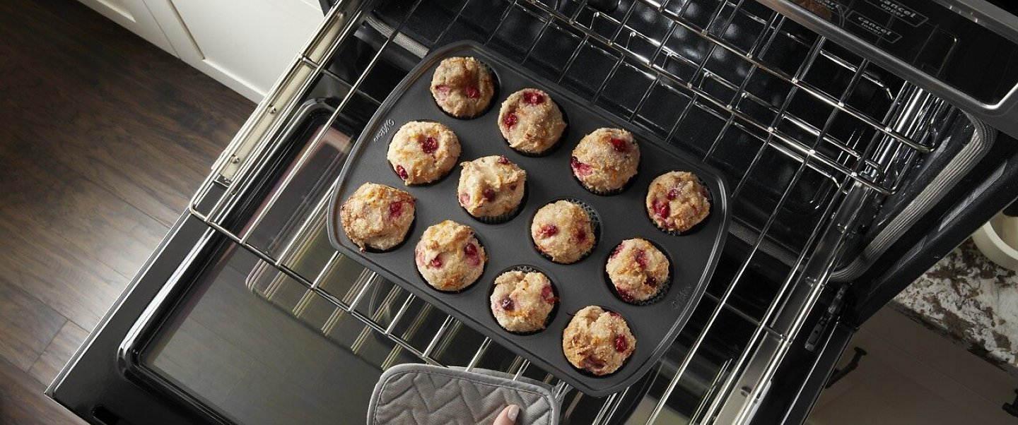 Rack of muffins going into the oven