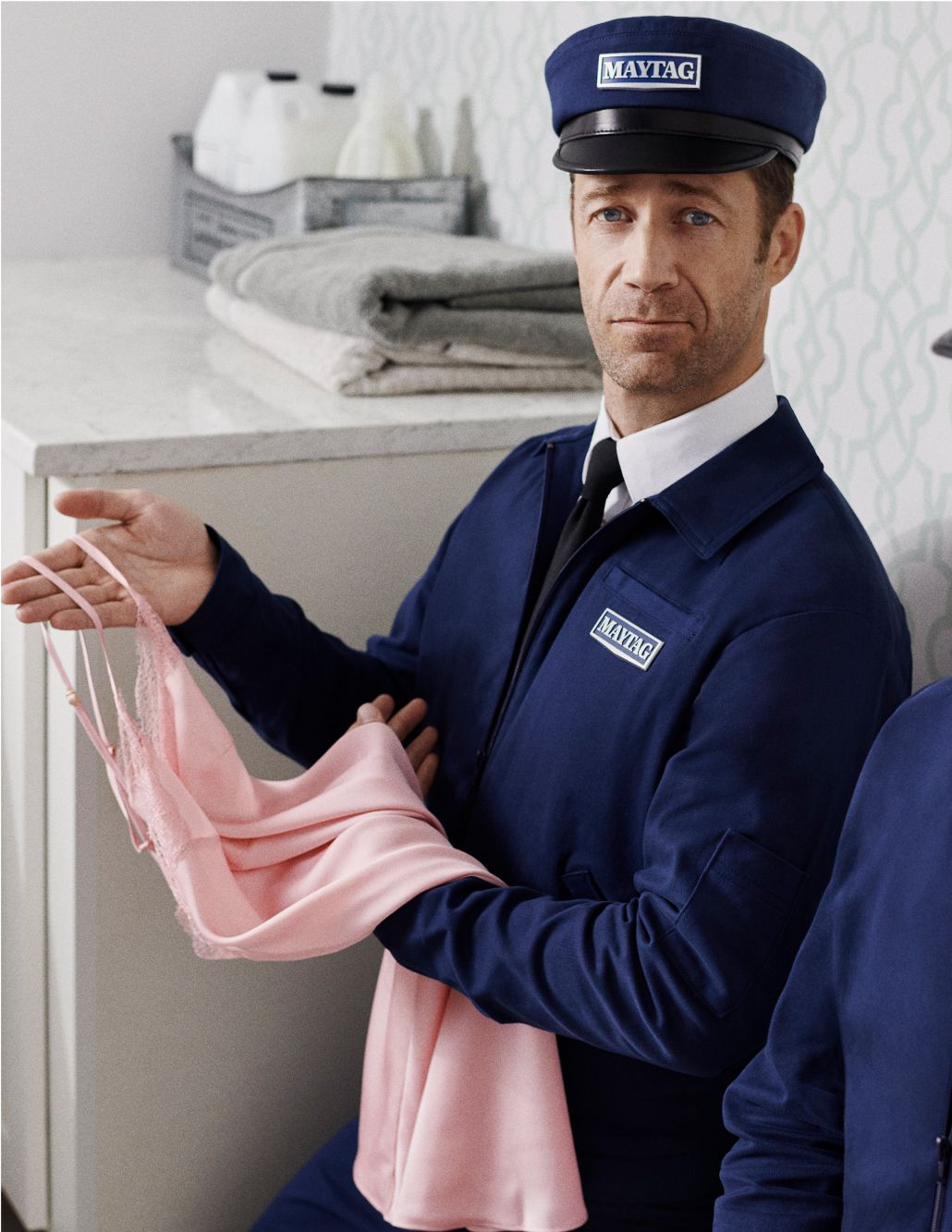Maytag man holding a nightie.