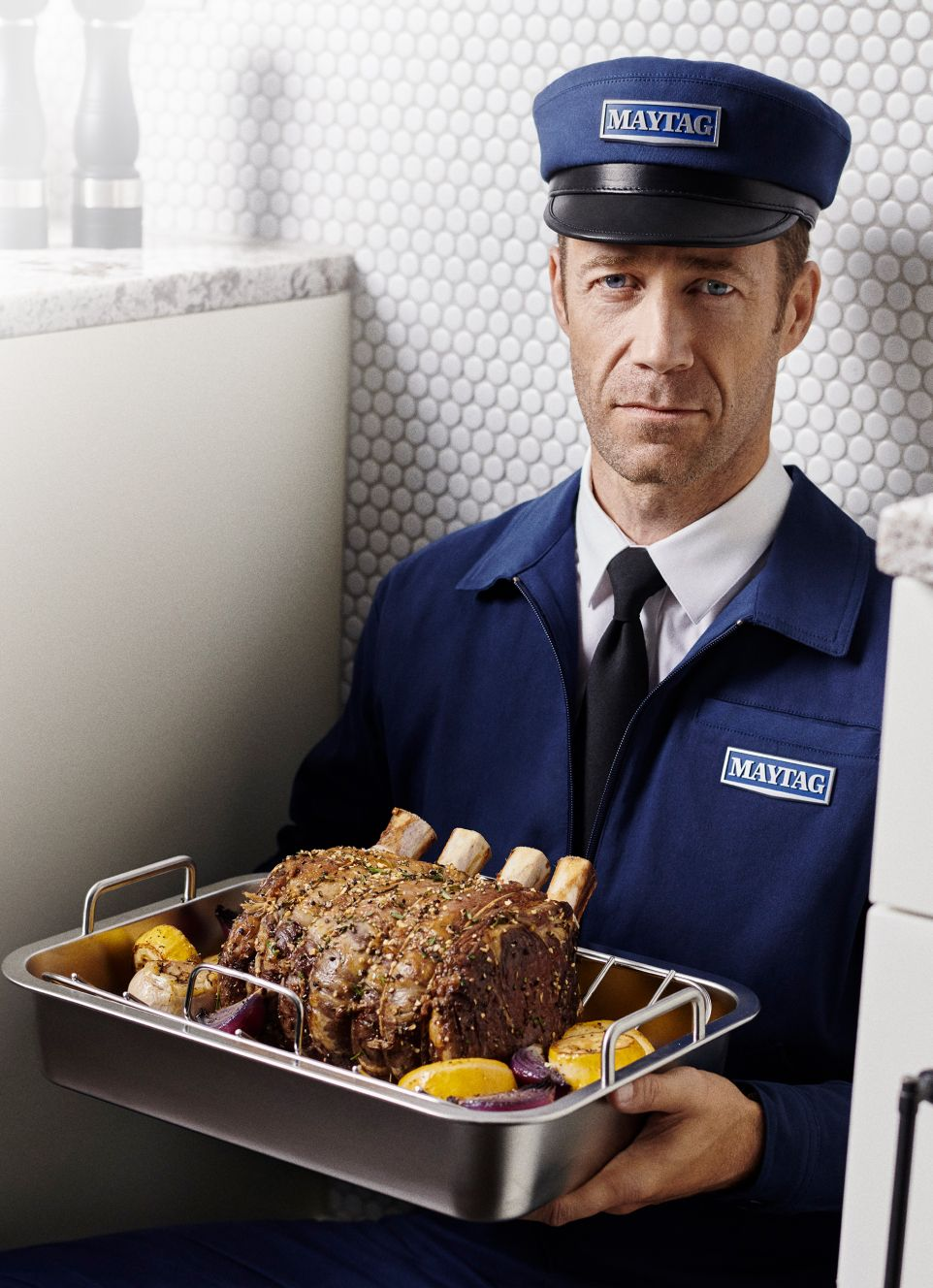 Maytag man holding a rack of lamb.