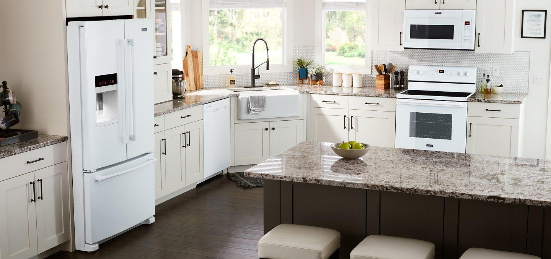 White Maytag® appliances in a white kitchen