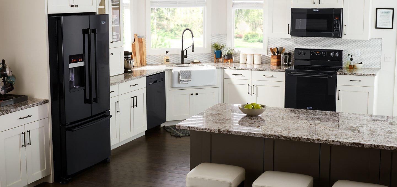 Black Maytag® appliances in a white kitchen