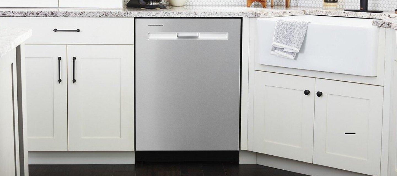 Maytag® dishwasher installed between white kitchen cabinets