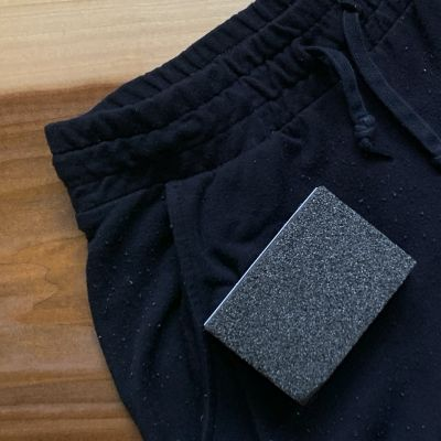 A sweater stone on a pair of sweatpants with fabric pills
