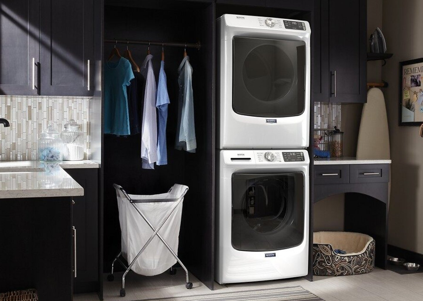 Stacked white Maytag® washer and dryer in laundry room