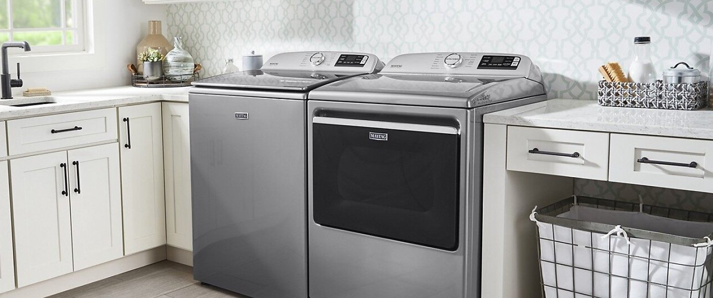 A laundry room with a Maytag® washing machine and dryer.