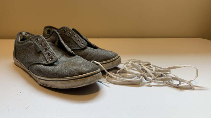 Dirty shoes with shoe laces removed