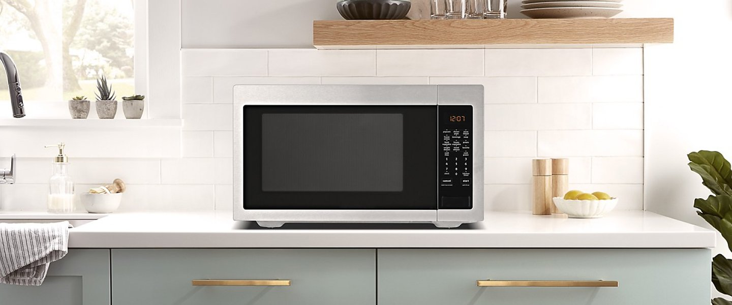 Stainless steel microwave on a counter