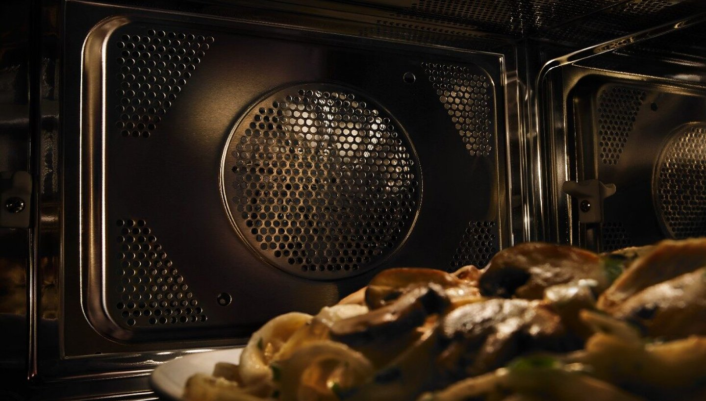 Close up of convection fan inside a microwave