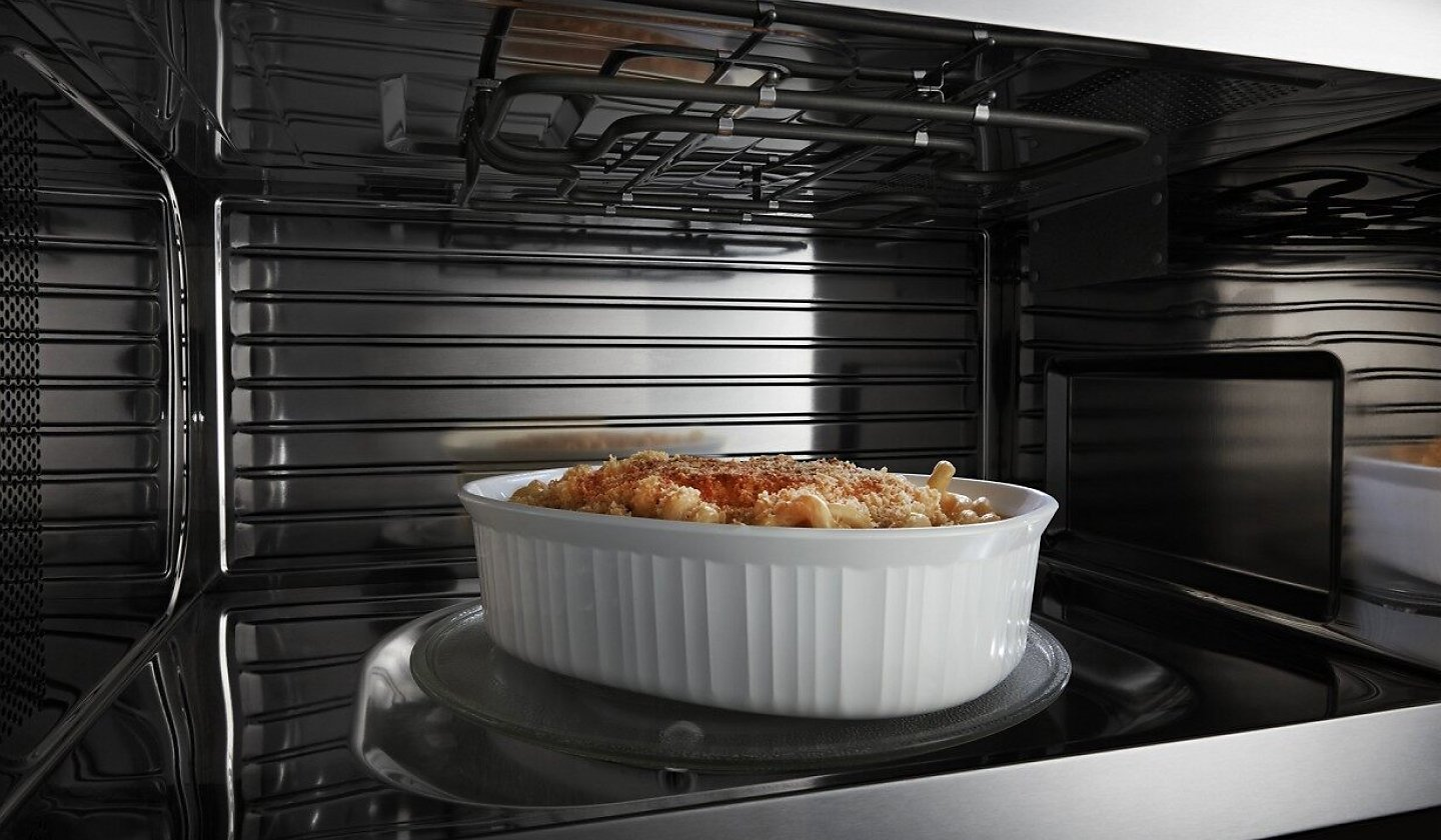 Macaroni and cheese crisping inside a microwave