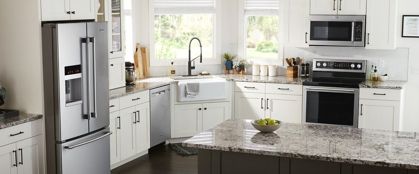 Suite of appliances in a bright, white kitchen