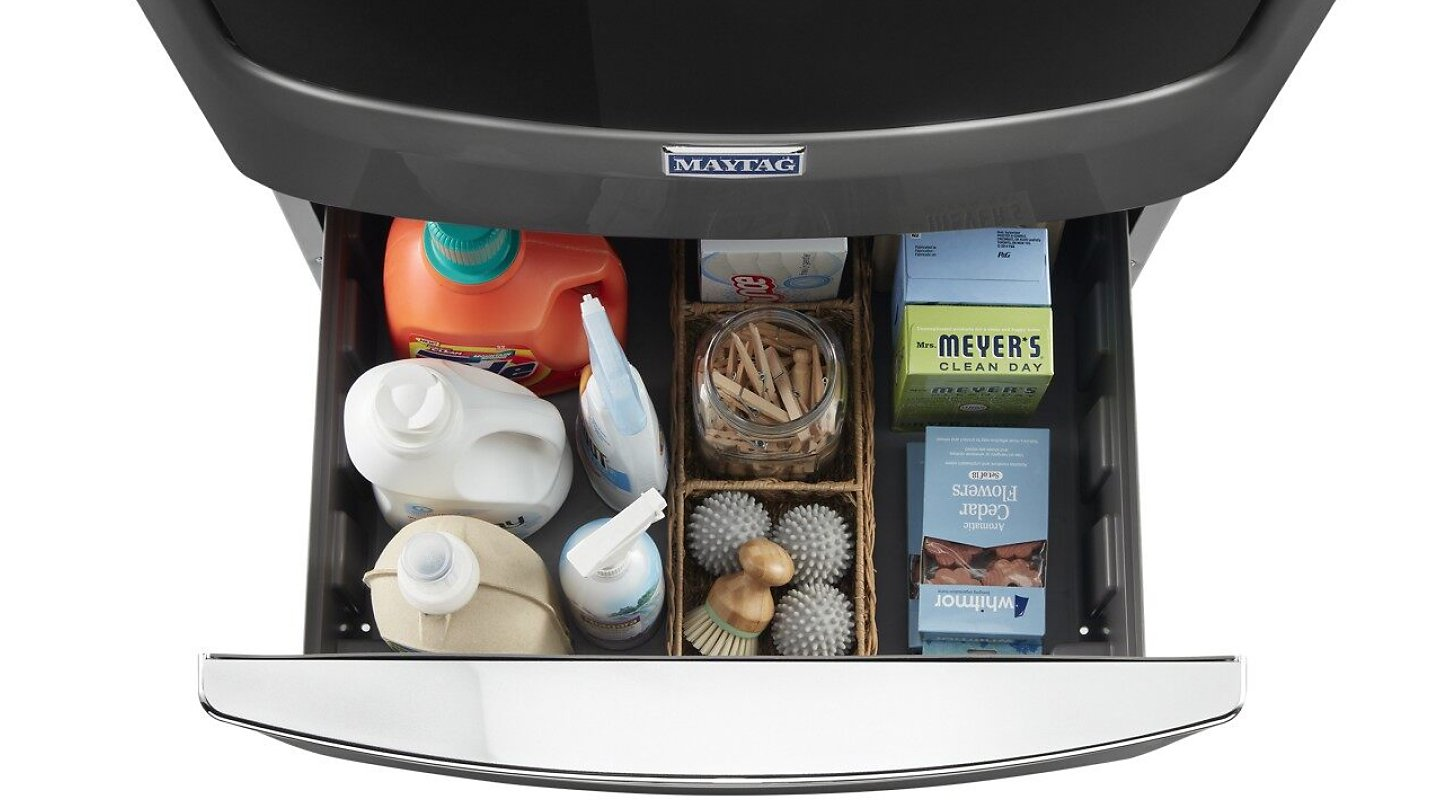 Overhead view of open laundry pedestal storage drawer with supplies inside
